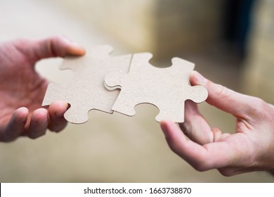 Cooperation puzzle partnership teamwork and business group team.