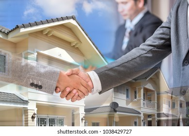 Cooperation signed on real estate. Business hand shaking on real estate background