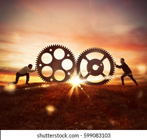 Cooperation at work concept with gears mechanism