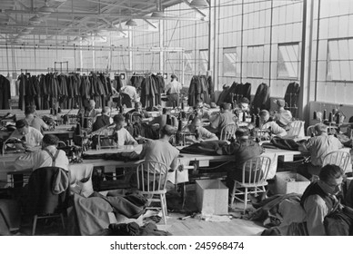 Cooperative garment factory at Jersey Homesteads, showing homesteaders at their work and some of the ladies' coats made by them. Nov. 1936.
