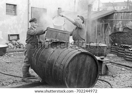 Coopers constructing a barrel