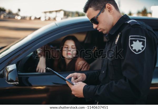 Cop Uniform Checks License Female Driver Stock Photo (Edit