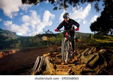 Copacabana Antioquia_ Colombia 01-27-2021 A white man descends a mountain on his bike while downhill