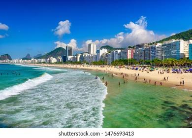 Copacabana beach and Leme beach in Rio de Janeiro, Brazil. Copacabana beach is the most famous beach in Rio de Janeiro. Sunny cityscape of Rio de Janeiro