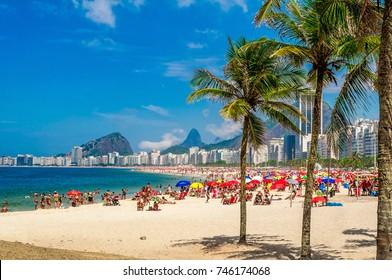 Copacabana beach (Praia de Copacabana) with palms in Rio de Janeiro, Brazil. Copacabana beach is the most famous beach of Rio de Janeiro
