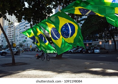Copacabana beach, Rio de Janeiro - April 17, 2016: Street vendors sell the national flags of Brazil during a protest against president Dilma Rousseff