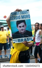 Copacabana beach, Rio de Janeiro, Brazil - December 4, 2016: A demonstrator holds a banner that reads We are all Sergio Moro, referring to Carwash judge Sergio Moro