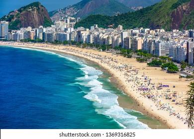 Copacabana beach in Rio de Janeiro, Brazil. Copacabana beach is the most famous beach of Rio de Janeiro, Brazil. Skyline of Rio de Janeiro.