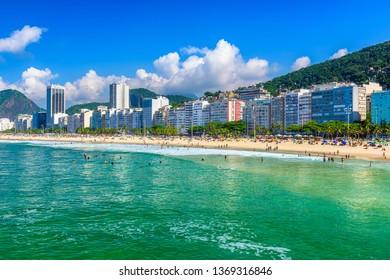 Copacabana beach in Rio de Janeiro, Brazil. Copacabana beach is the most famous beach in Rio de Janeiro. Sunny cityscape of Rio de Janeiro