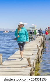 COPACABANA, BOLIVIA, MAY 7, 2014: Young tourist on jetty in port