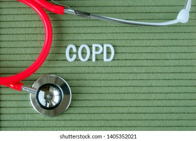 COPD, Chronic obstructive pulmonary disease - text from white letters on a green background with a stethoscope, medical concept diagnosis, treatment, healthcare.