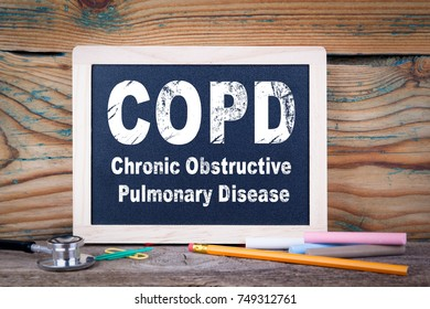 copd, Chronic obstructive pulmonary disease. Chalkboard on a wooden background