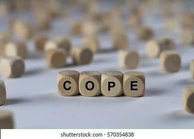 cope - cube with letters, sign with wooden cubes