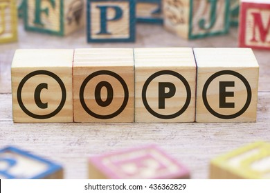 Cope word written on wood cube