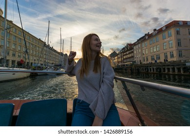 Copenaghen, Denmark, Europe - 1st May 2019 -Smiling blonde girl excited during a boat trip in Nyhavn, Copenaghen, Danmark.