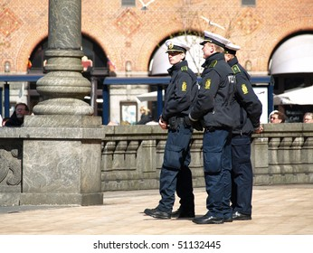 COPENHAGEN - APR 16:  Danish policemen guard and secure the Copenhagen City Hall during the celebration of Queen Margrethe's 70th birthday on April 16, 2010 in Copenhagen.