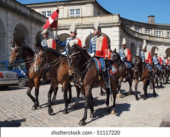 COPENHAGEN - APR 16: The Danish Royal Military guards mounted on horses parading the city  and escorting the queen for the celebration of Queen Margrethe's 70th birthday on April 16, 2010, Denmark in Copenhagen.
