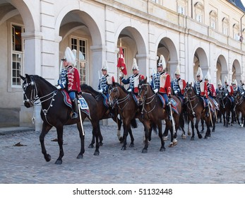 COPENHAGEN - APR 16: The Danish Royal guards on horses escorts the queen during the celebration of Queen Margrethe's 70th birthday on April 16, 2010 in Copenhagen, Denmark in Copenhagen.