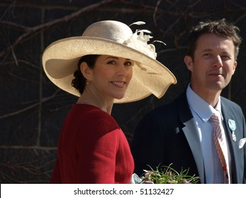 COPENHAGEN - APR 16: HRH Crown Prince Frederik and Princess Mary smile at the crowd in front of the Copenhagen City Hall during the celebration of Queen Margrethe's 70th birthday on April 16, 2010 in Copenhagen.