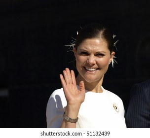 COPENHAGEN - APR 16: HRH Crown Princess Victoria of Sweden waves at the crowd for the  celebration of Queen Margrethe's 70th birthday on April 16, 2010 at Copenhagen City Hall in Copenhagen.