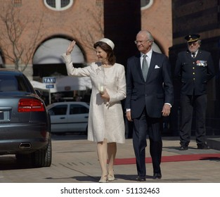COPENHAGEN - APR 16: HRH Queen Silvia and King Harald of Sweden waves at the crowd during celebration of Queen Margrethe's 70th birthday on April 16, 2010 at Copenhagen City Hall in Copenhagen.
