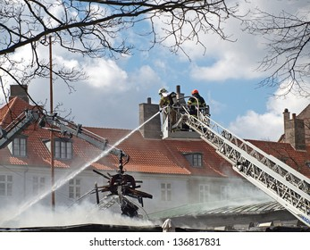 COPENHAGEN - APR 28: Firemen controls fire at The Museum of Danish Resistance 1940 -1945 on April 28, 2013 in Copenhagen, Denmark. It took 10 hours to put off the fire which started at 1:45 A.M.