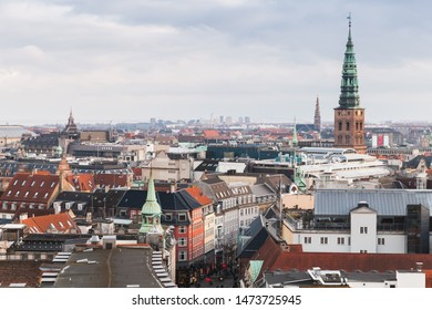 Copenhagen cityscape with spire of ol City Hall at winter day. Photo taken from The Round Tower, popular old city landmark and viewpoint. Denmark