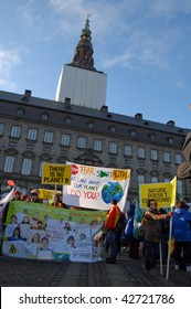 COPENHAGEN - DEC 12: Demonstrators hold placards in front of the parliament at the UN Climate Change Conference on December 12, 2009 in Copenhagen, Denmark.