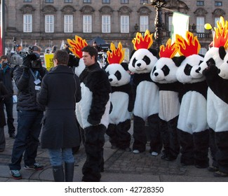 COPENHAGEN - DEC 12: A man dresses in a panda suit gives interview at the big demonstration UN conference on Climate Change on December 12, 2009 in Copenhagen.