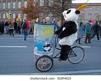COPENHAGEN - DEC 12: Panda on a bicycle on the way to the big demonstration against climate change on December 12, 2009.