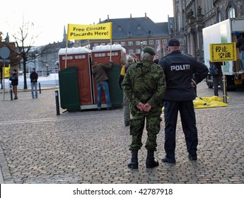 COPENHAGEN - DEC 12: The police and army keep a watchful eye on activists setting up their stand during the UN Conference on Climate Change on December 12, 2009 in Copenhagen.