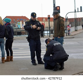 COPENHAGEN - DEC 12: Police stop and search a bag belonging to a young man before the protest marches  during the Climate Conference on December 12, 2009 in Copenhagen