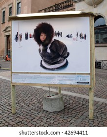 COPENHAGEN - DEC 12: Poster showing an eskimo which is part of the WWF exhibit in Copenhagen during the Climate Conference December 12, 2009