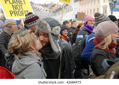 COPENHAGEN - DEC 12: A young couple kiss at the demonstrations at the UN Climate Change Conference on December 12, 2009 in Copenhagen.