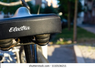 Copenhagen, Østerbro/Oesterbro / Denmark - 06 07 2018: A bicycle saddle on a rusty and worn Electra cruiser bike with some smooth bokeh and a warm summer feeling from the sunlight.