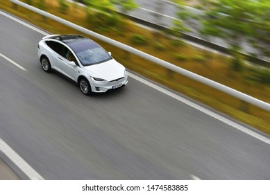 Copenhagen / Denmark - 07.22.19: Modern electric crossover car Tesla Model X is driving by highway on high speed