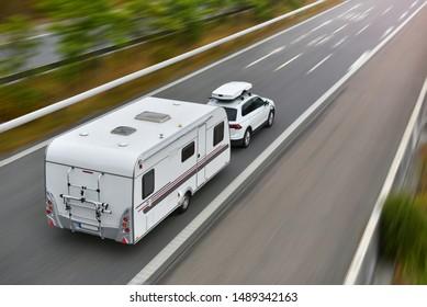 Copenhagen / Denmark - 07.22.19: travel on car with caravan trailer by highway