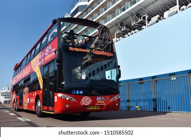 Copenhagen / Denmark - 07.25.19: Red sightseeing double decker bus Ayats Bravo of Hop on Hop off excursion company is carrying tourists from cruise liner to city