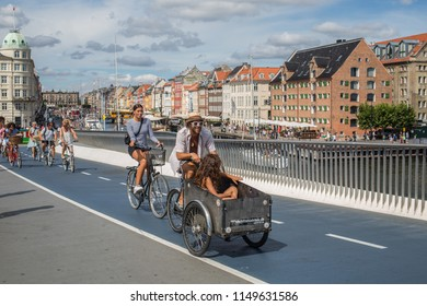 Copenhagen / Denmark - 08 04 2018: Bicycles on a small bridge in central Copenhagen.