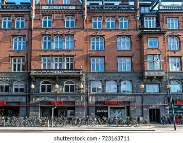 Copenhagen, Denmark, 10 March 2016 - Copenhagen street. Colorful street, doors, windows, red and yellow walls and bikes with basket in old town. View of Copenhagen, Denmark