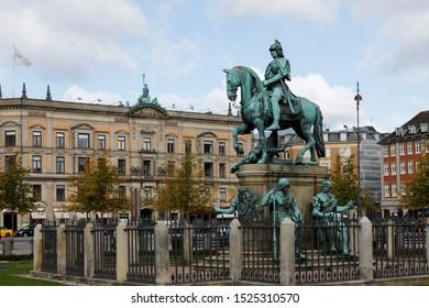 Copenhagen, Denmark, 10/2/2019. Kongens Nytorv. The monument is an an equestrian statue of King Christian V.