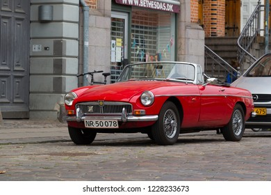 Copenhagen, Denmark - 12 September, 2017: A red sports car MG MGB 1800 convertible on the street of Copenhagen