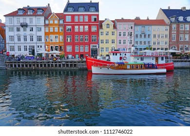 COPENHAGEN, DENMARK -15 MAY 2018- Sunset view of colorful buildings lining the waterfront in Nyhavn, a 17th-century canal and entertainment district in Copenhagen, Denmark.
