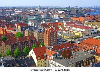 COPENHAGEN, DENMARK -15 MAY 2018- Panoramic landscape view of the center of Copenhagen seen from the top of the landmark Church of Our Saviour (Vor Frelsers Kirke) with a helix spire and staircase.