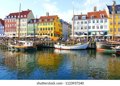 COPENHAGEN, DENMARK -15 MAY 2018- View of colorful buildings lining the waterfront in Nyhavn, a 17th-century canal and entertainment district in Copenhagen, Denmark.