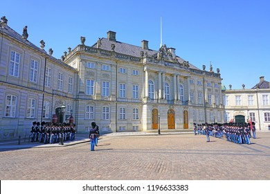 COPENHAGEN, DENMARK -15 MAY 2018- View of Royal Guards (Den Kongelige Livgarde) on the Palace Square at the Amalienborg Palace. Denmark is still a monarchy.