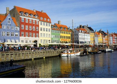 COPENHAGEN, DENMARK -24 SEP 2018- View of colorful buildings lining the waterfront in Nyhavn, a 17th-century canal and entertainment district in Copenhagen, Denmark.