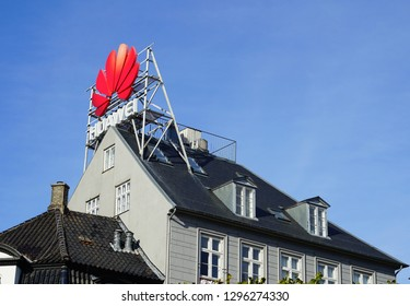 COPENHAGEN, DENMARK -24 SEP 2018- View of a giant sign with the logo of Chinese tech telecom company Huawei above a building in Nyhavn in Copenhagen, Denmark.