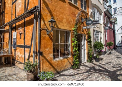 COPENHAGEN, DENMARK - 24TH MAY 2017: Colourful architecture and shops in Copenhagen during the day.
