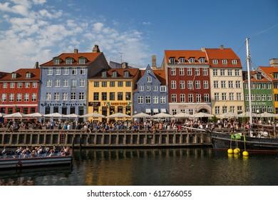 COPENHAGEN, DENMARK - 25 JUN 2016: Nyhavn canal is full of people at sunny day